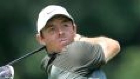 McIlroy charges into contention