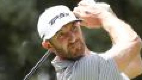 Johnson leads as McIlroy falters