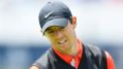 Late birdie gives McIlroy hope