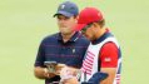 Reed's caddie barred after clash with fan