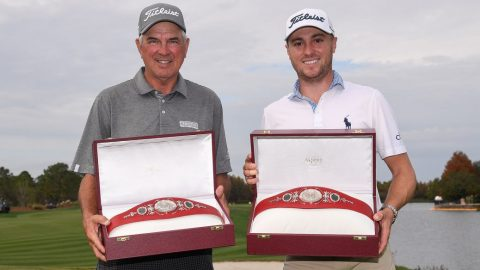 Justin Thomas shows off champion's belt at dinner with Tiger and Charlie Woods
