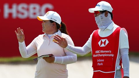 With husband filling in as caddie, Inbee Park shoots 64 to lead in Singapore